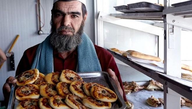 Một trong những người Syria khởi nghiệp với tiệm bánh tại Amman, Jordan. Ảnh: Internet