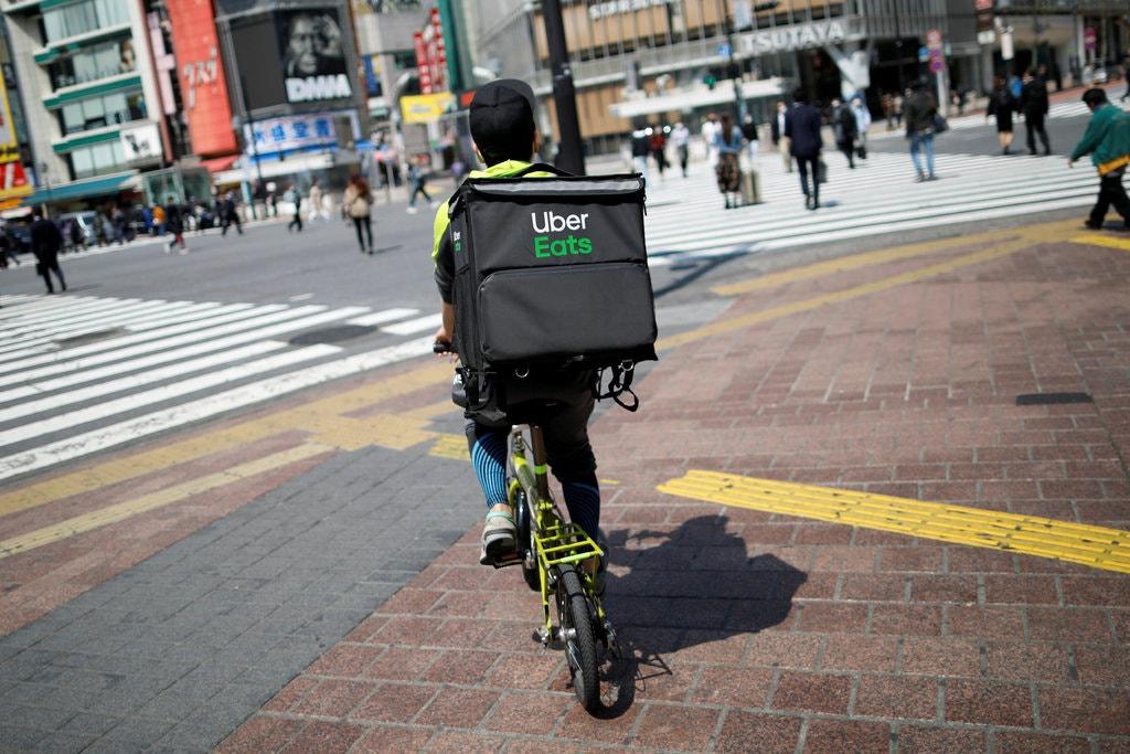 Uber vừa thông báo mua Postmates với giá 2,65 tỷ USD. Ảnh: The New York Times